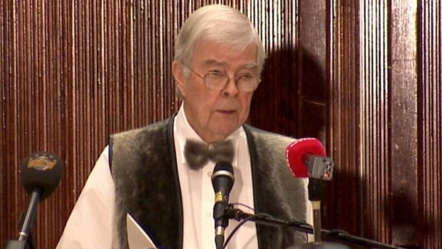 John Crosbie, seen wearing a sealskin bowtie and vest during a 2012 speech, has spearheaded the sealers' memorial in Elliston.