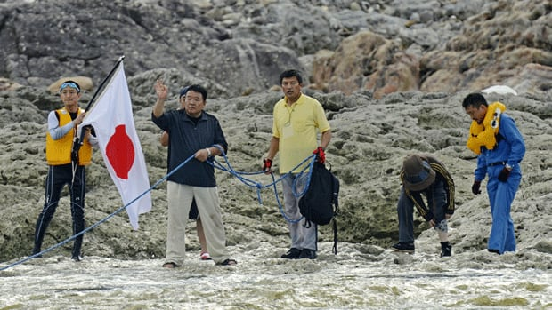 Unidentified members from a Japanese nationalist group land on Uotsuri island, part of the disputed islands in the East China Sea.