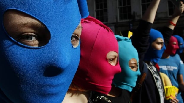 Protesters wearing masks take part in an Amnesty International flash mob demonstration in support of Russian punk band Pussy Riot in the Royal Mile in Edinburgh, Scotland on Tuesday.