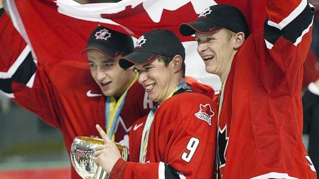 From left, Canada's Patrice Bergeron, Sidney Crosby and Corey Perry celebrate their gold medal victory at the 2005 world junior hockey championship. Teammate Mike Richards believes the shared history could help them succeed at the 2014 Olympics.