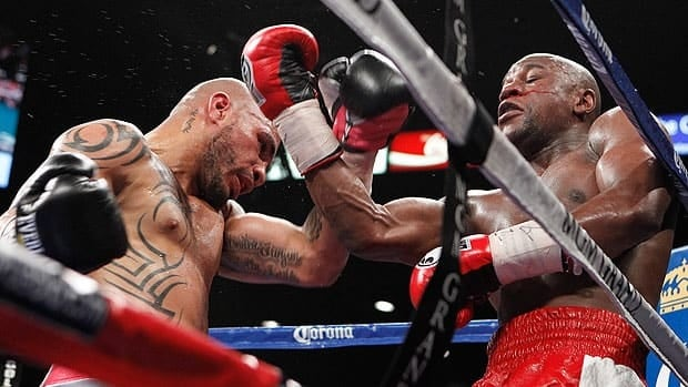 Miguel Cotto often pinned Floyd Mayweather against the ropes and in the corner, but it was the American who generally landed the sharper punches.