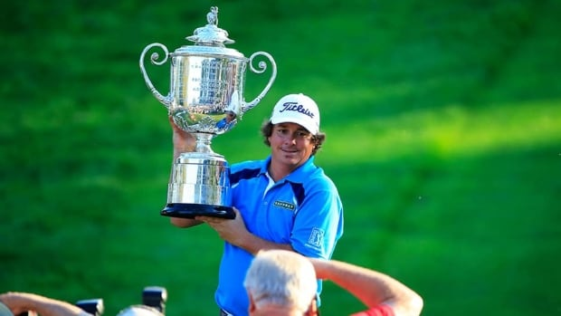 Jason Dufner of the United States poses for photographers with the Wanamaker Trophy after his two-stroke victory at the 95th PGA Championship at Oak Hill Country Club on Sunday in Rochester, New York.