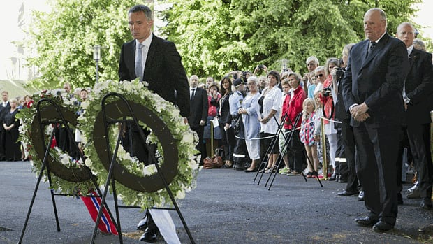 Norway's King Harald, right, and Prime Minister Jens Stoltenberg, attend a wreath-laying ceremony at a memorial to mark the one-year anniversary of the twin Oslo-Utoeya massacre by self-confessed killer Anders Breivik.