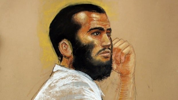 """In this photo of a sketch by courtroom artist Janet Hamlin, Canadian defendant Omar Khadr attends a hearing in the courthouse for the U.S. military war crimes commission at the Camp Justice compound on Guantanamo Bay U.S. Naval Base in Cuba, April 28, 2010. An FBI agent said Khadr admitted throwing a grenade that killed a U.S. soldier in Afghanistan during an interview that the agent described on Wednesday as """"comfortable"""" and """"friendly,"""" once the hood and handcuffs were removed."""