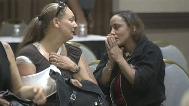 Phoenix Sinclair's one-time foster mom, Kim Edwards, left, reacts to news on Thursday that a publication ban would not be granted.