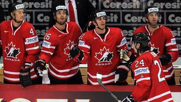 Canada players celebrate scoring against Kazakhstan during a preliminary round of the IIHF International Ice Hockey World Championship in Helsinki on May 12, 2012.
