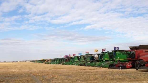 Combines line up in an effort to break the Guinness World Record.