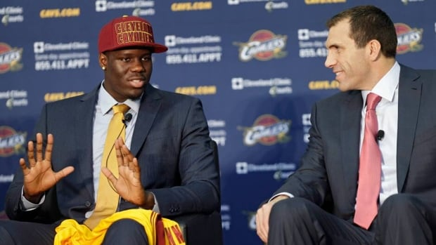 Anthony Bennett, left, answers questions with Cavaliers general manager Chris Grant during a news conference on June 28, 2013.