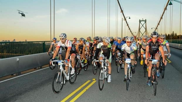 Cyclists going across the Lionsgate Bridge.