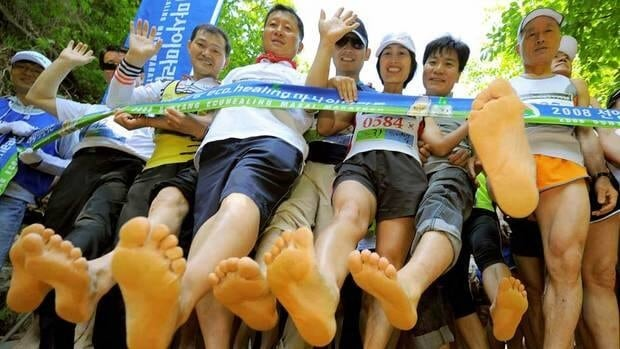 Barefoot runners, like these at the start line of the Sunyang Masai Marathon in South Korea, may be at risk of suffereing stress fractures if they convert too quickly from running in shoes.