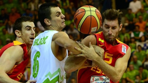 Rudy Fernandez, right, and Victor Claver, left, of Spain battle for the ball with Jure Balazic, centre, of Slovenia at the EuroBasket 2013 Championships on Thursday.