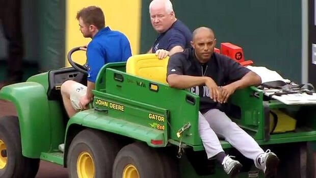 In this image taken from video, New York Yankees' Mariano Rivera, right, is being carted off the field after twisting his right knee shagging fly balls during batting practice before the Yankees' game against the Kansas City Royals.