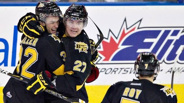 Brandon Wheat Kings' Michael Ferland, centre, celebrates his goal with Ryley Miller and Eric Roy.