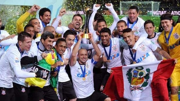 Brazil's Corinthians officials and players pose after winning the 2012 Club World Cup in Yokohama on Sunday.