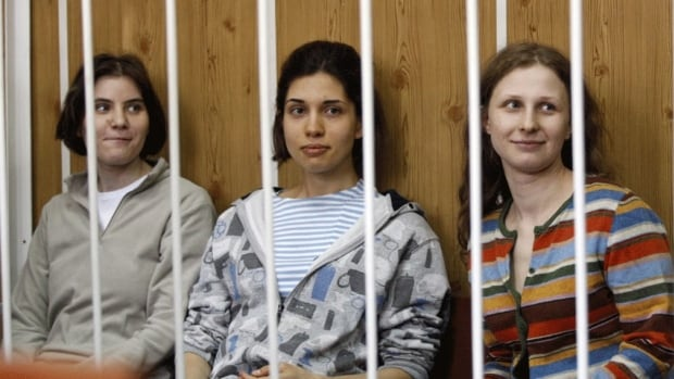 Three members of the Russian band Pussy Riot — Nadezhda Tolokonnikova (centre), Maria Alyokhina (right) and Yekaterina Samutsevich — were detained in February after they stormed into Moscow's main cathedral to sing a protest song against Vladimir Putin and criticized the Russian Orthodox Church.