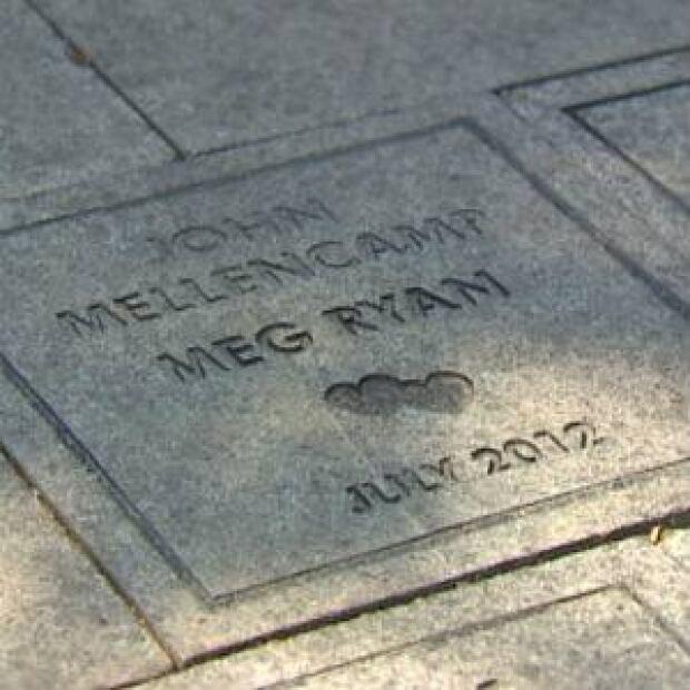 nl-mellencamp-and-ryan-memory-stone-20130822
