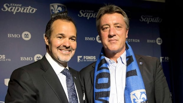 Montreal Impact chairman Joey Saputo, left, and head coach Marco Schallibaum at a news conference January 8, 2013 in Montreal.