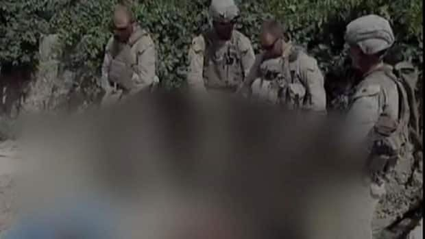 Navy investigators have been called in after an unverified video appeared to show a group of Marines urinating on corpses. This blurred image is part of an unverified video posted online.