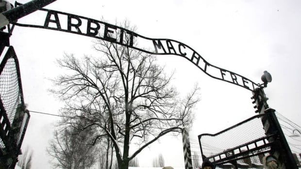 """The notorious sign reading Arbeit Macht Frei — meaning """"work makes you free"""" — greeted prisoners at the entrance gate of the Auschwitz Nazi concentration camp in Oswiecim, southern Poland."""