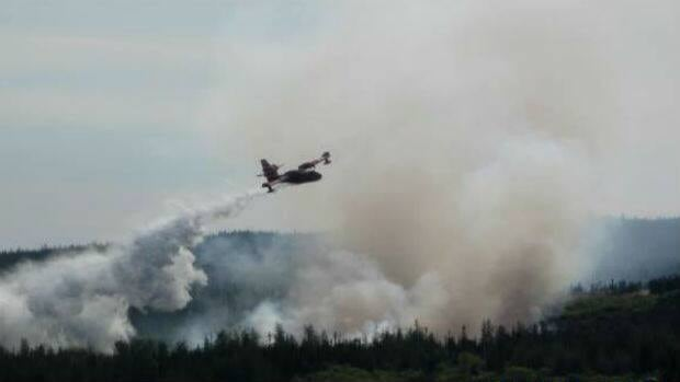 A water bomber was called in Sunday to help tackle a fire just outside Rigolet.