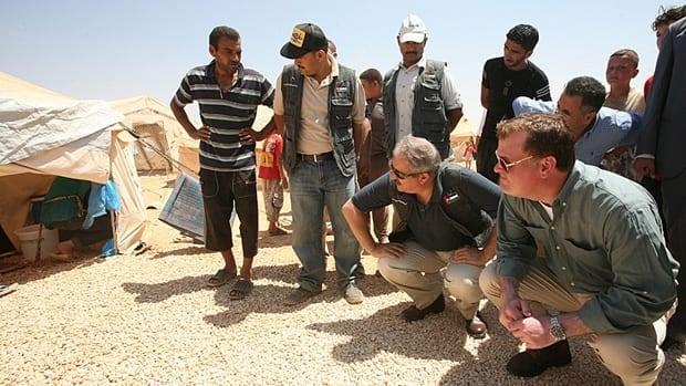 Jordanian Foriegn Minister Nasser Judeh, center and Foreign Minister John Baird, right, visited the Zaatari camp for Syrian refugees in Mafraq, Jordan last August.