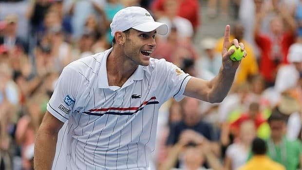 Andy Roddick gestures to the crowd during his third round match at Arthur Ashe Stadium on Sunday.