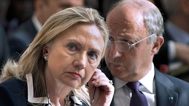 U.S. Secretary of State Hillary Clinton and French Foreign Minister Laurent Fabius attend the Friends of Syria conference in Paris on Friday.