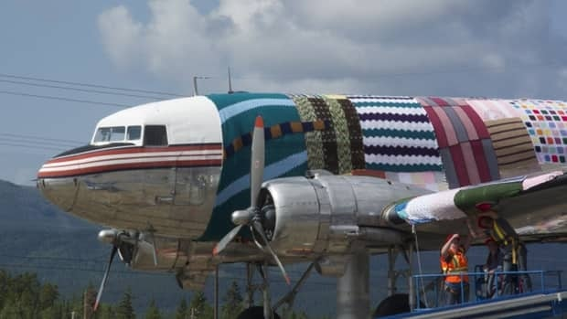People from all over contributed squares of wool to the pattern that covers the DC-3 aircraft.
