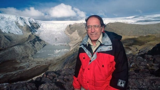 Lonnie Thompson in a field photo with Peru's Qori Kalis glacier, which is flowing down from the Quelccaya ice cap. The lake did not exist before 1991.