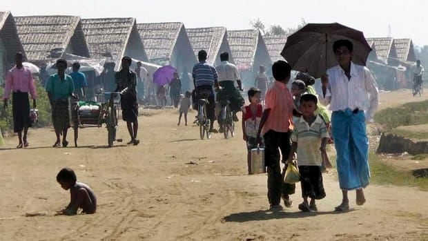 Muslim refugees walk about at a refugee camp in Sittwe, Rakhine state, in western Myanmar.
