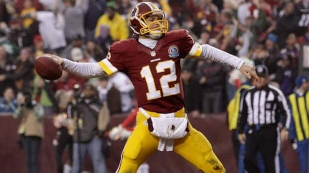 Washington Redskins quarterback Kirk Cousins spikes the ball after a two point conversion against the Baltimore Ravens in Landover, Md., Sunday, Dec. 9, 2012.