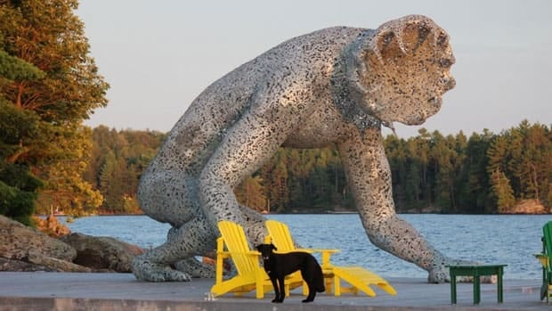 Andrew Cumming purchased Koilos, a sculpture standing more than four metres tall, and is displaying it on his Muskoka-area cottage dock after becoming worried it was being damaged in Toronto.
