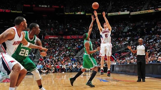 Atlanta Hawks guard Kirk Hinrich shoots over Paul Pierce of the Boston Celtics in Game 5 on Tuesday night.