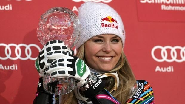 Lindsey Vonn shows the trophy of the women's World Cup downhill discipline title on Wednesday, March 14, 2012 in Schladming, Austria.