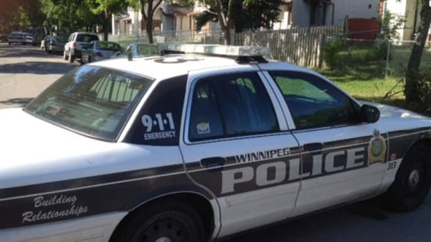 Winnipeg police check out reports of a man carrying a gun in the Tyndall Park area Tuesday.