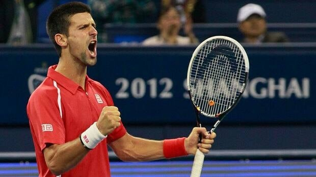 Novak Djokovic celebrates after winning a game against Andy Murray in the Shanghai Masters final Sunday.