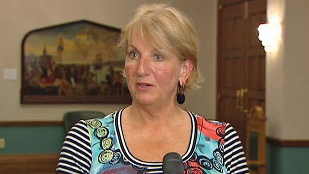 Newfoundland and Labrador Premier Kathy Dunderdale, seen while speaking with reporters in July, says she is not concerned about public opinion polls.