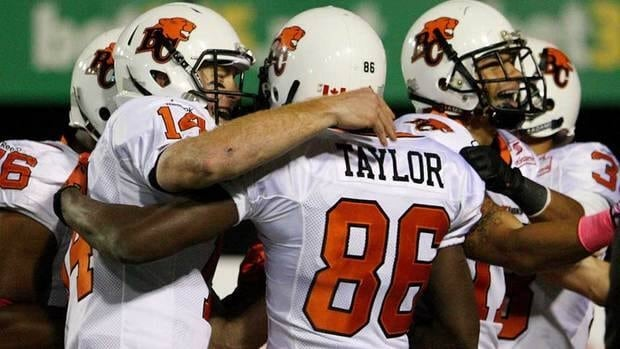 B.C. Lions quarterback Travis Lulay celebrates a touchdown by Courtney Taylor during the first half against the Hamilton Tiger-Cats, in Hamilton on Friday.