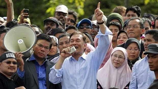 Malaysia's opposition leader Anwar Ibrahim talks to his supporters after being acquitted of sodomy. The government says the verdict in the trial shows the country's judiciary is independent of undue influence.
