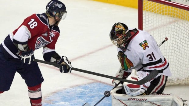 Portland Winterhawks goalie Mac Carruth, shown here last year in the WHL playoffs against Tri-City, will be without his coach for the rest of the season.