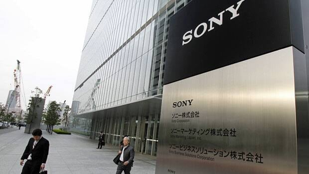 Workers leave Sony's Tokyo headquarters last month. The company Thursday reported a loss of 255 billion yen ($3.2 billion) for the January-March period.