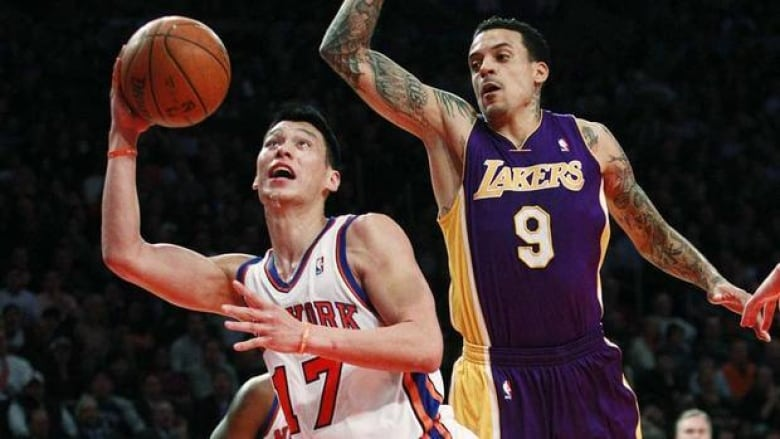 New York Knicks  Jeremy Lin (17) drives past Los Angeles Lakers  Matt  Barnes on Friday night. Lin is the hottest story in the NBA. 90e617c6d