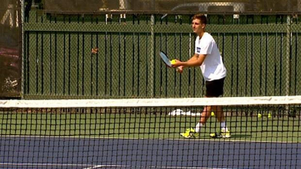 Filip Peliwo, 19, prepares to serve the ball at the Calgary Tennis Club on Sunday.