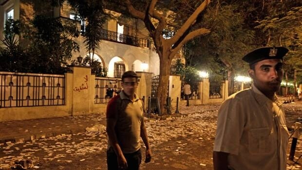 An Egyptian police officer stands guard outside the destroyed campaign office of Egyptian presidential candidate Ahmed Shafiq after hundreds of anti-Shafiq protesters attacked and tried to set fire to the building.