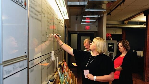 At the COAST office, Terry McGurk, Esther Bulk and Linda Stansfield look at cases on the office white board. COAST dealt with 550 youth with mental health issues in 2011. (Larry Strung)