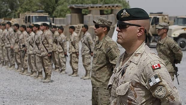 Canadian and U.S. soldiers mark Canada's handover of a base to U.S. forces in Kandahar, Afghanistan last summer. Shipping containers bringing military equipment back to Canada following the end of the combat mission there have been broken into, CBC News has learned.