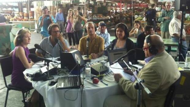 CBC journalists (left to right) Nancy Wood, Shawn Apel, Elias Abboud and Kristy Snell take the Radio Noon quiz with host Bernard St-Laurent at the Jean Talon Market.