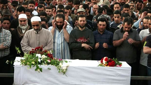 Mourners pray over the body of Mohamed Hassan Hameed, who was killed by Syrian gunfire whilst trying to enter into Syria, during his funeral in the northern Lebanese border town of Arsal on June 7, 2012.
