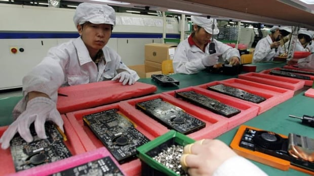 Staff members work at a Foxconn complex in Shenzhen, China, in May. A factory in the city of Yantai was found to have interns under the minimum legal working age of 16, the company said Tuesday.