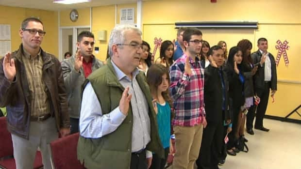 Eighteen people officially become Canadian citizens during a ceremony in St. John's in September 2013.
